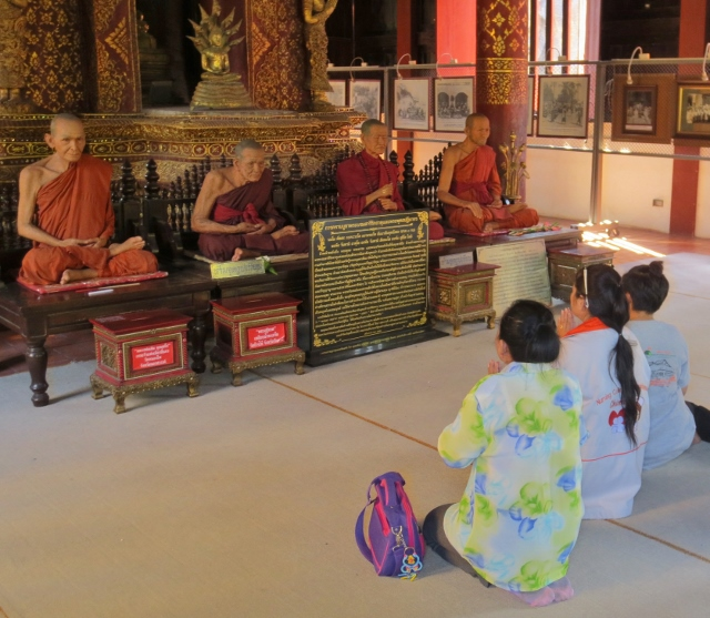 Buddhists praying